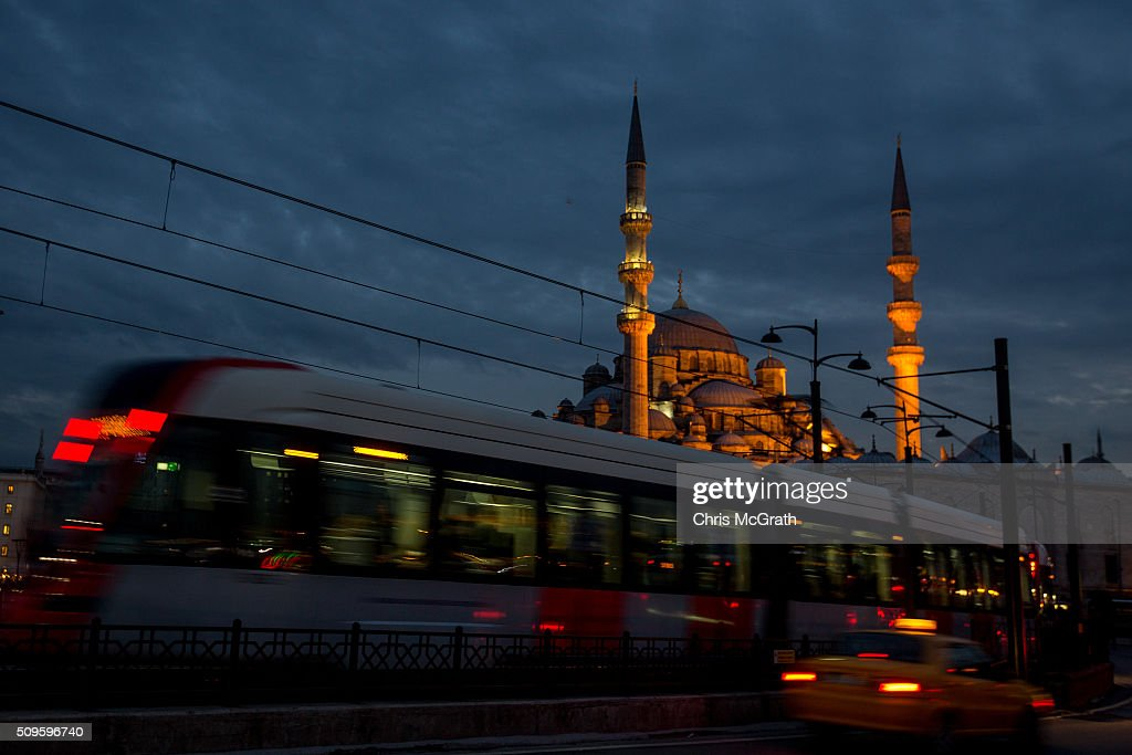 A tram passes in front of the Eminonu Mosque on February 11, 2016 in Istanbul, Turkey. Istanbul is famous for its skyline dotted with historic mosques, it is home to more than 3000 mosques, the most of any city in Turkey and includes the famous Blue Mosque and Suleymaniye Mosque.