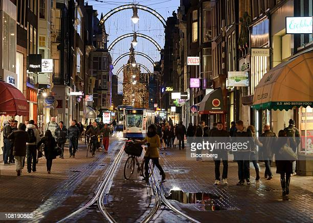 A tram passes pedestrians in the center of Amsterdam Netherlands on Wednesday Jan19 2011 European stocks fell for a second day as accelerating...
