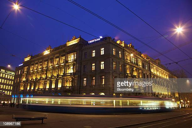 A tram passes the Credit Suisse AG company headquarters in Zurich Switzerland on Thursday Feb 10 2011 Credit Suisse Group AG Switzerland's...