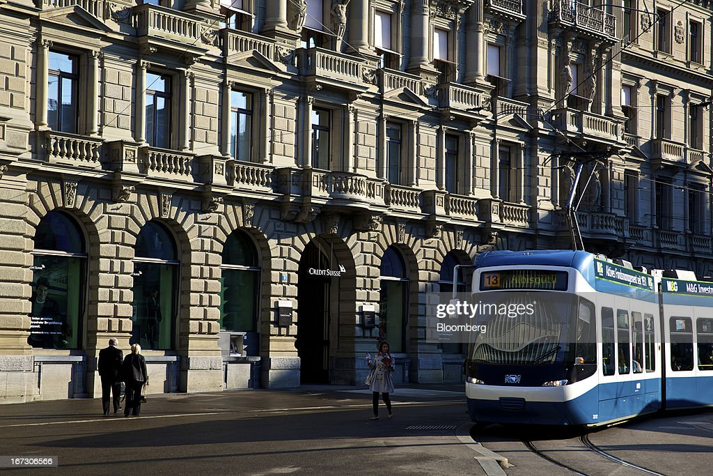 A tram passes the headquarters of Credit Suisse Group AG in Zurich, Switzerland, on Wednesday, April 24, 2013. Credit Suisse Group AG, the second- biggest Swiss bank, posted a jump in first-quarter profit as year-earlier charges related to its own debt and bonus payments weren't repeated. Photographer: Gianluca Colla/Bloomberg via Getty Images