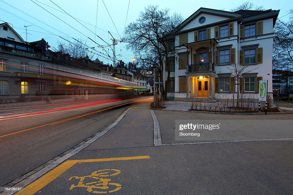 A tram passes the headquarters of Notenstein Privatbank AG, formerly the headquarters of Wegelin & Co., in St. Gallen, Switzerland, on Wednesday, March 20, 2013. Wegelin & Co., who sold Notenstein Privatbank AG to Raiffeisen Group last year, were ordered to pay U.S. authorities almost $58 million at the end of a criminal case after the Swiss bank pleaded guilty to helping American taxpayers hide more than $1.2 billion from the Internal Revenue Service. Photographer: Gianluca Colla/Bloomberg via Getty Images