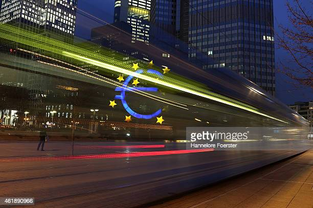 A tram passes the symbol of the Euro the currency of the Eurozone on January 21 2015 in Frankfurt Germany The European Central Bank is schedule to...