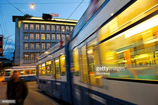 A tram passes the UBS AG headquarters on Paradeplatz in Zurich Switzerland on Friday May 1 2009 UBS AG the European bank with the biggest writedowns...