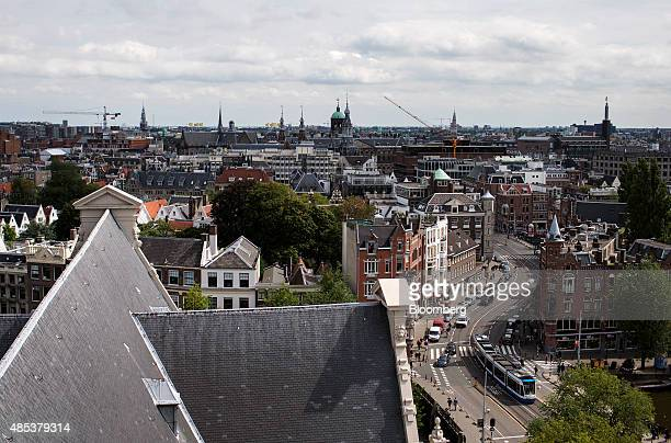 A tram passes through a traditional Dutch street in Amsterdam Netherlands on Wednesday Aug 26 2015 Seven years after a global financial crisis was...