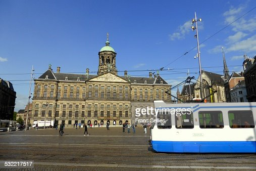 Tram passing Dam square, royal palace in Amsterdam