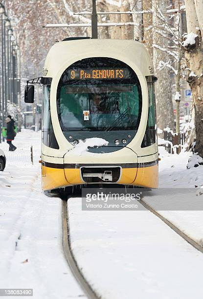 A tram runs in the snow on February 2 2012 in Milan Italy The cold front sweeping over the country has affected regions from Piedmont to Sicily...