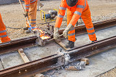 Tram track construction site, tracks being joined.Thermite welding of the rail joints.