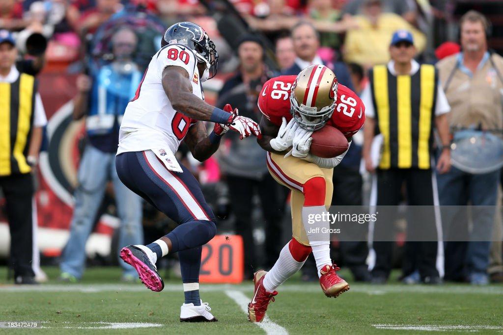 Tramaine Brock of the San Francisco 49ers intercepts a pass to score a touchdown against Matt Schaub of the Houston Texans in the first quarter...
