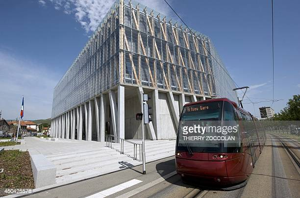 A trammway rides by the new Hotel de la Region Auvergne in ClermontFerrand central France on June 10 2014 French President Francois Hollande proposed...