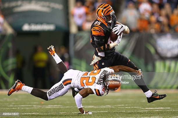 Tramon Williams of the Cleveland Browns attempts to tackle Tyler Eifert of the Cincinnati Bengals during the fourth quarter at Paul Brown Stadium on...