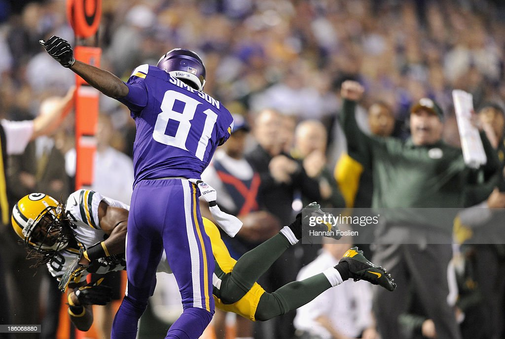 <a gi-track='captionPersonalityLinkClicked' href=/galleries/search?phrase=Tramon+Williams&family=editorial&specificpeople=749225 ng-click='$event.stopPropagation()'>Tramon Williams</a> #38 of the Green Bay Packers breaks up a pass intended for <a gi-track='captionPersonalityLinkClicked' href=/galleries/search?phrase=Jerome+Simpson&family=editorial&specificpeople=5085139 ng-click='$event.stopPropagation()'>Jerome Simpson</a> #81 of the Minnesota Vikings as head coach Mike McCarthy of the Green Bay Packers looks on during the second quarter of the game on October 27, 2013 at Mall of America Field at the Hubert H. Humphrey Metrodome in Minneapolis, Minnesota. The Packers defeated the Vikings 44-31.