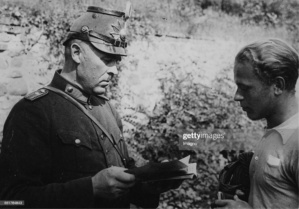 Tramp on German roads Control of 'Hiking permission' for under 18yearold boys and girls by a gendarme About 1930 Germany Photograph