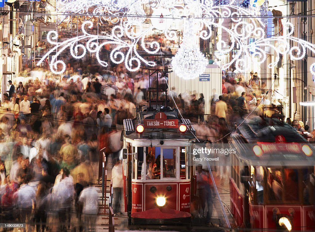 Trams in busy street at night : Stock Photo