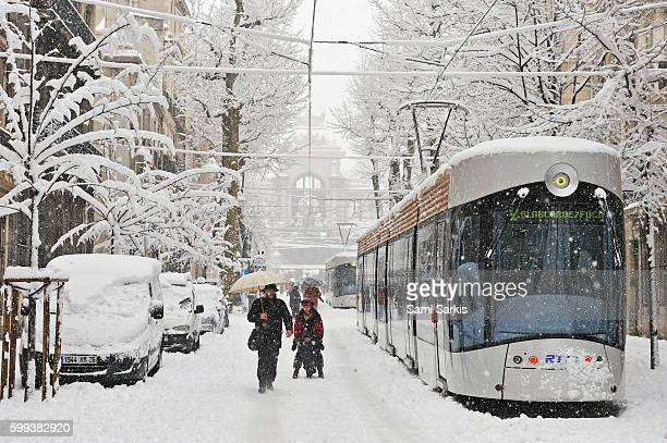 Tramway and people on boulevard Longchamps, Marseille, France after heavy snow