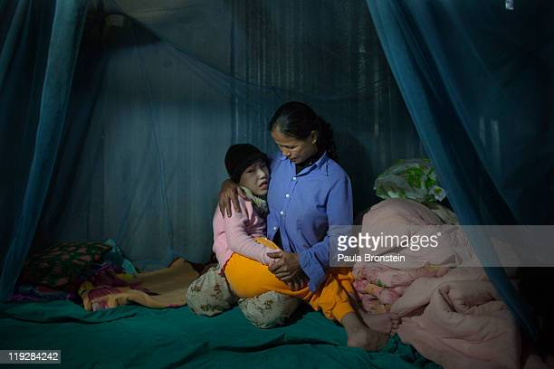 CAM LO VIETNAM MARCH 8 Tran Thi Nghien sits with her handicapped daughter Hung at their home March 8 in Cam Lo in Quang Tri province Vietnam Many of...
