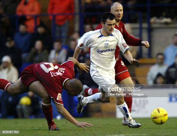Tranmere Rovers' Chris Dagnall gets past Walsall's Julian Bennett to score the second goal