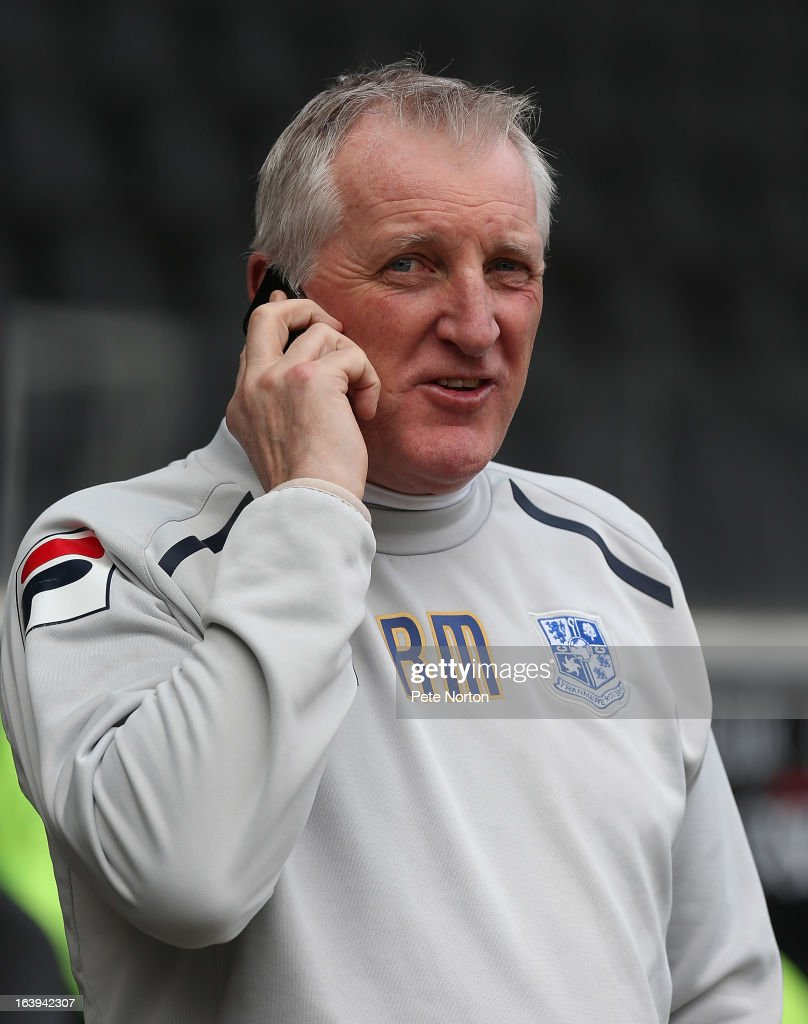 Tranmere Rovers manager Ronnie Moore talks on his mobile phone prior to the npower League One match between MK Dons and Tranmere Rovers at Stadium MK on March 16, 2013 in Milton Keynes, England.