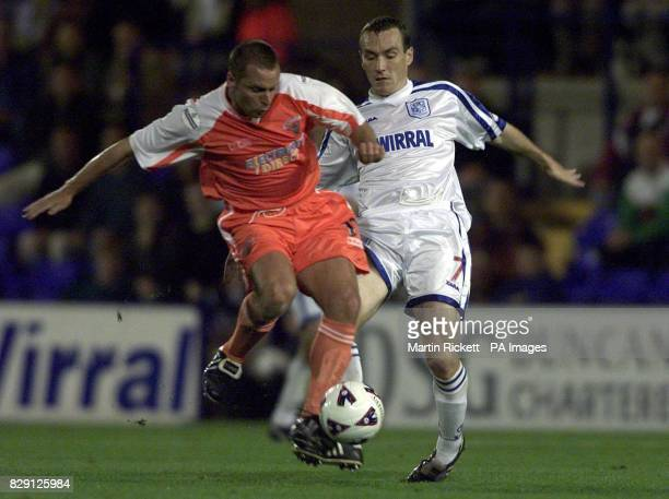 Tranmere's Mickey Mellon battles with Paul Simpson during the Nationwide Division Two game between Tranmere Rovers and Blackpool at Prenton Park THIS...