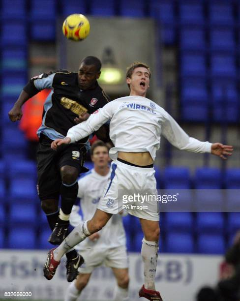 Tranmere's Steve Davies loses out to the high ball to Rotherham's Delroy Facey during the CocaCola League One match at Prenton Park Birkenhead