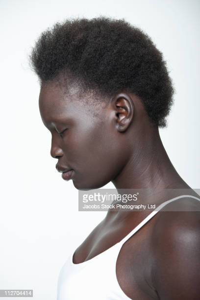 Tranquil Black woman with eyes closed