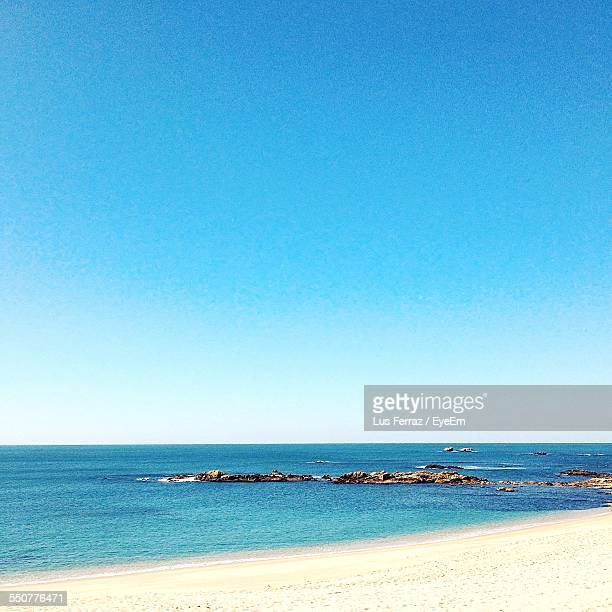 Tranquil Scene Of Sea Against Clear Blue Sky