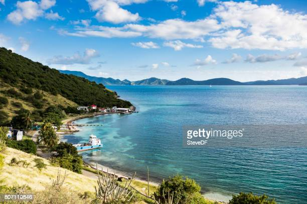 Tranquil Shore of a Beautiful Caribbean Bay with Anchored Sailboats