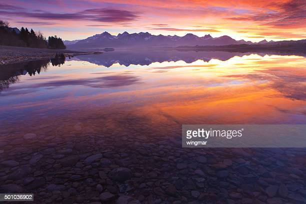 tranquil sunset at lake forggensee in bavaria - germany