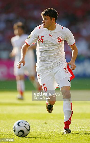 Tranquillo Barneta of Switzerland runs with the ball during the FIFA World Cup Germany 2006 Group G match between France and Switzerland at the...