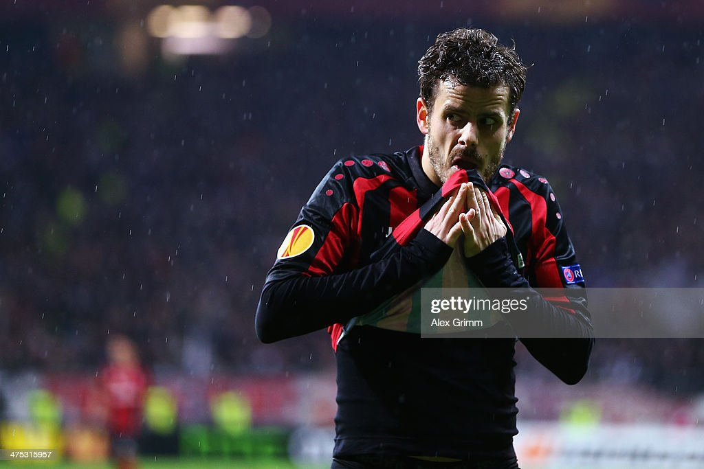 <a gi-track='captionPersonalityLinkClicked' href=/galleries/search?phrase=Tranquillo+Barnetta&family=editorial&specificpeople=534444 ng-click='$event.stopPropagation()'>Tranquillo Barnetta</a> of Frankfurt reacts during the UEFA Europa League Round of 32 second leg match between Eintracht Frankfurt and FC Porto at Commerzbank Arena on February 27, 2014 in Frankfurt am Main, Germany.