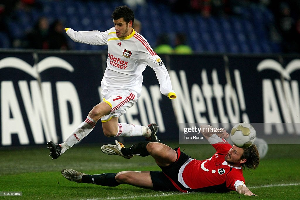 Tranquillo Barnetta of Leverkusen is challenged by Christian Schulz of Hannover during the Bundesliga match between Hannover 96 and Bayer Leverkusen...