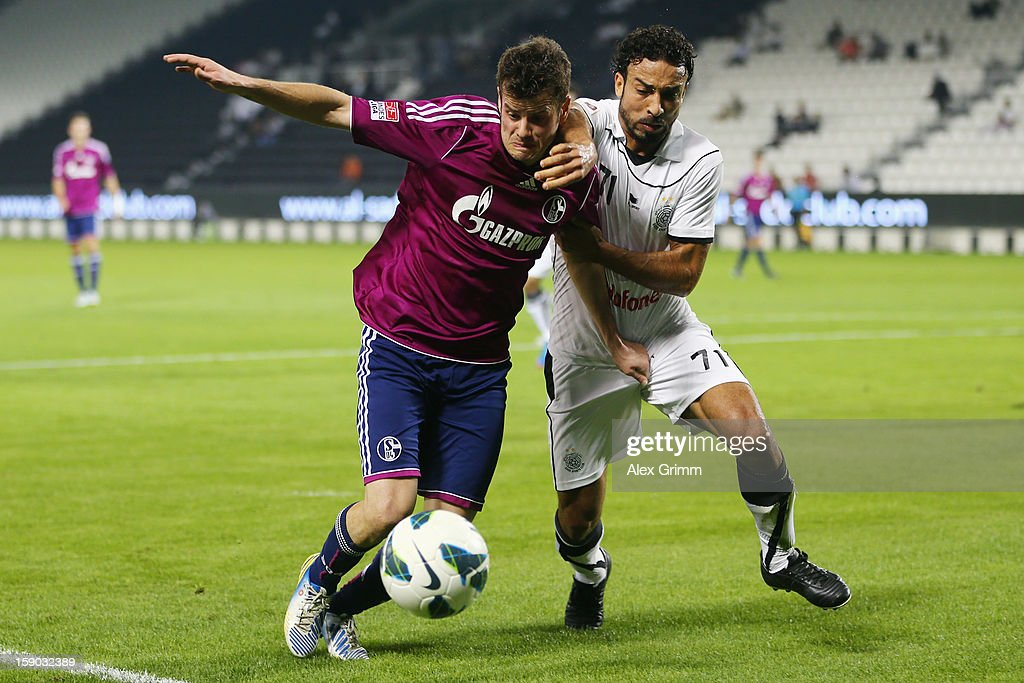<a gi-track='captionPersonalityLinkClicked' href=/galleries/search?phrase=Tranquillo+Barnetta&family=editorial&specificpeople=534444 ng-click='$event.stopPropagation()'>Tranquillo Barnetta</a> (L) of Schalke is challenged by Othman Al Assas (L) of Al Sadd during the friendly match between Al-Sadd Sports Club and FC Schalke 04 at Jassim Bin Hamad Stadium on January 6, 2013 in Doha, Qatar.