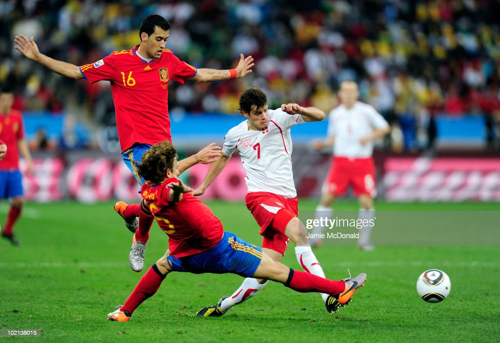 <a gi-track='captionPersonalityLinkClicked' href=/galleries/search?phrase=Tranquillo+Barnetta&family=editorial&specificpeople=534444 ng-click='$event.stopPropagation()'>Tranquillo Barnetta</a> of Switzerland comes under pressure from Carles Puyol of Spain during the 2010 FIFA World Cup South Africa Group H match between Spain and Switzerland at Durban Stadium on June 16, 2010 in Durban, South Africa.