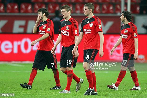 Tranquillo Barnetta Toni Kroos Lars Bender and Gonzalo Castro of Leverkusen look dejected after losing 02 the Bundesliga match between Bayer...