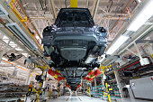 Automated car Assembly line. plant of automotive industry. Shop for production and Assembly of machines bottom view