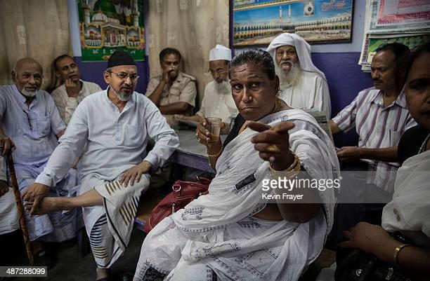 Transgender Candidate Hijra Guru Baseer Kinnar aka Kamala Kinnar speaks to Muslim men while campaigning at a tea shop in a Muslim neighbourhood on...