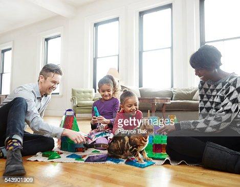 Transgender dad plays w/ daughters in living room