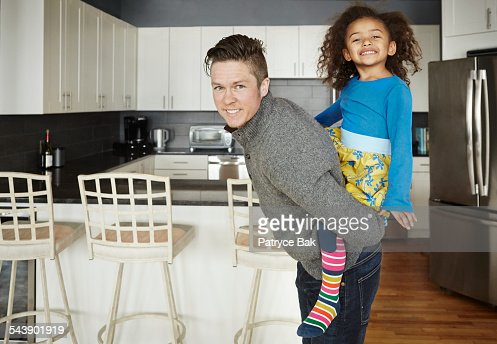 Transgender dad plays with daughter in the kicthen