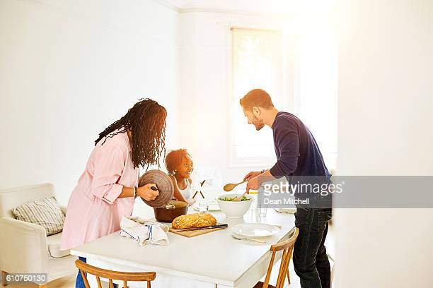 Transgender family at dining table in kitchen