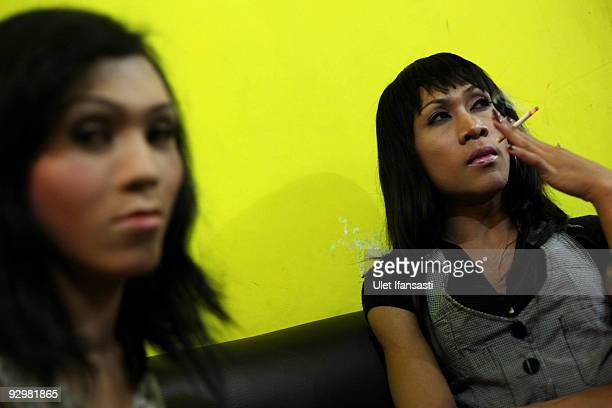 Transgender named Hera Puspita and Maria Novita rest after working as a makeup girl and a escort in a night club on November 10 2009 in Yogyakarta...