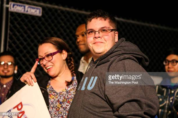 Transgender teen Gavin Grimm right and Vanessa Ford left mother of a transgender child join a protest outside White House in support of trans...