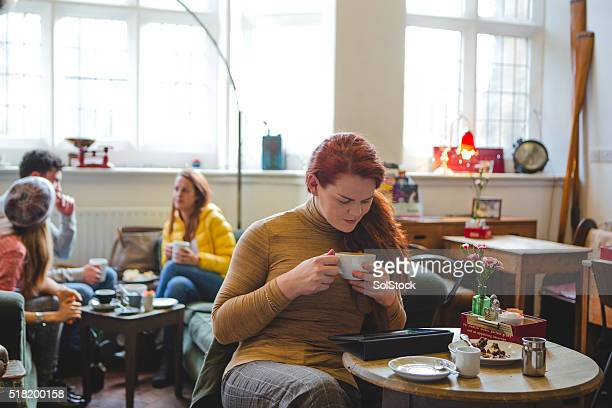 Transgender Woman Sitting in Coffee Shop