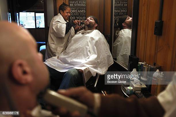 Transit Police Officer Kurt Power an Army Veteran Purple Heart recipient and former Home Base patient gets shaved by Lynnette Jones of Mobile Cuts in...