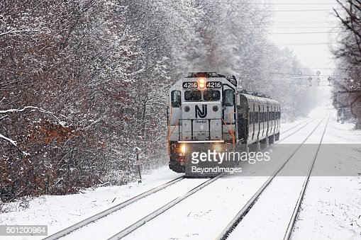 NJ Transit push-pull commuter train in winter snow