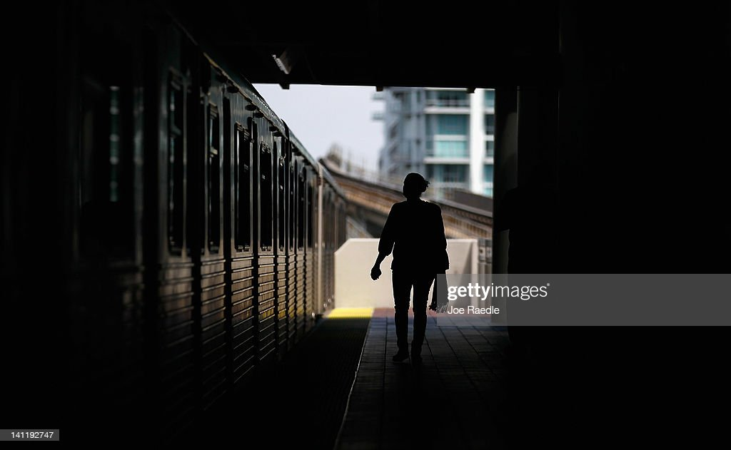 A transit rider stands on the platform of the Miami-Dade county Metrorail system on March 12, 2012 in Miami, Florida. With gas prices on the rise, mass transit systems around the country have seen a 2.31 percent rise in ridership during 2011 over the previous year according to the American Public Transportation Association.