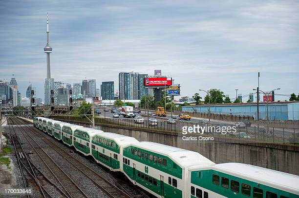 Transit train heads east towards downtown Toronto while traffic starts to build on the Gardiner Expressway on June 5 2013 This photograph was taken...