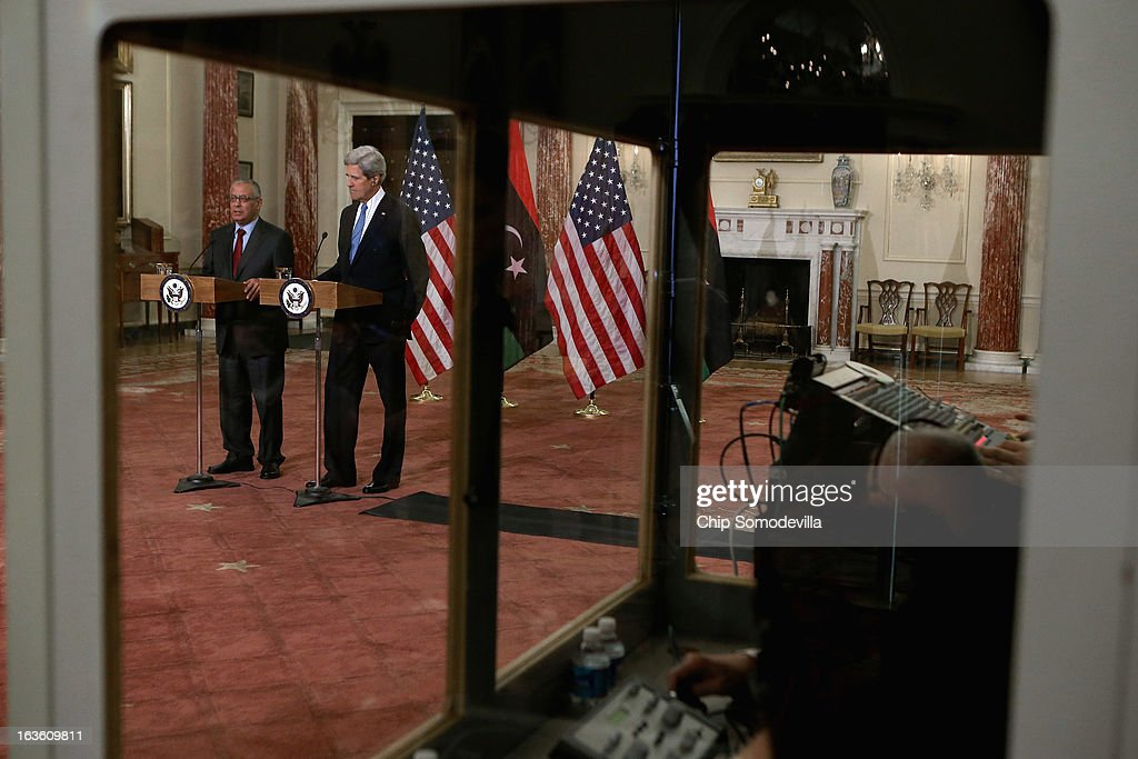Translators work in a sound-proof booth as Libyan Prime Minister Ali Zeidan (L) and U.S. Secretary of State <a gi-track='captionPersonalityLinkClicked' href=/galleries/search?phrase=John+Kerry&family=editorial&specificpeople=154885 ng-click='$event.stopPropagation()'>John Kerry</a> hold a news conference in between bilateral meetings in the Ben Franklin Room at the State Department on March 13, 2013 in Washington, DC. The two leaders took time in between meetings to make statements to the news media.