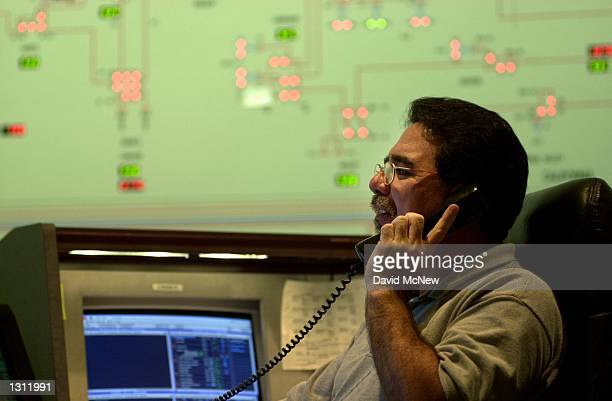 Transmission dispatcher David Pierce is alerted by phone to a stage two emergency when electrical reserves in the region are dropping to 5 percent or...
