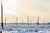 transmission facilities in snowy field sunny industrial