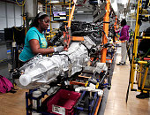 A transmission for a Chrysler Ram 1500 truck goes through the assembly line at the Warren Truck Assembly Plant September 25 2014 in Warren Michigan...