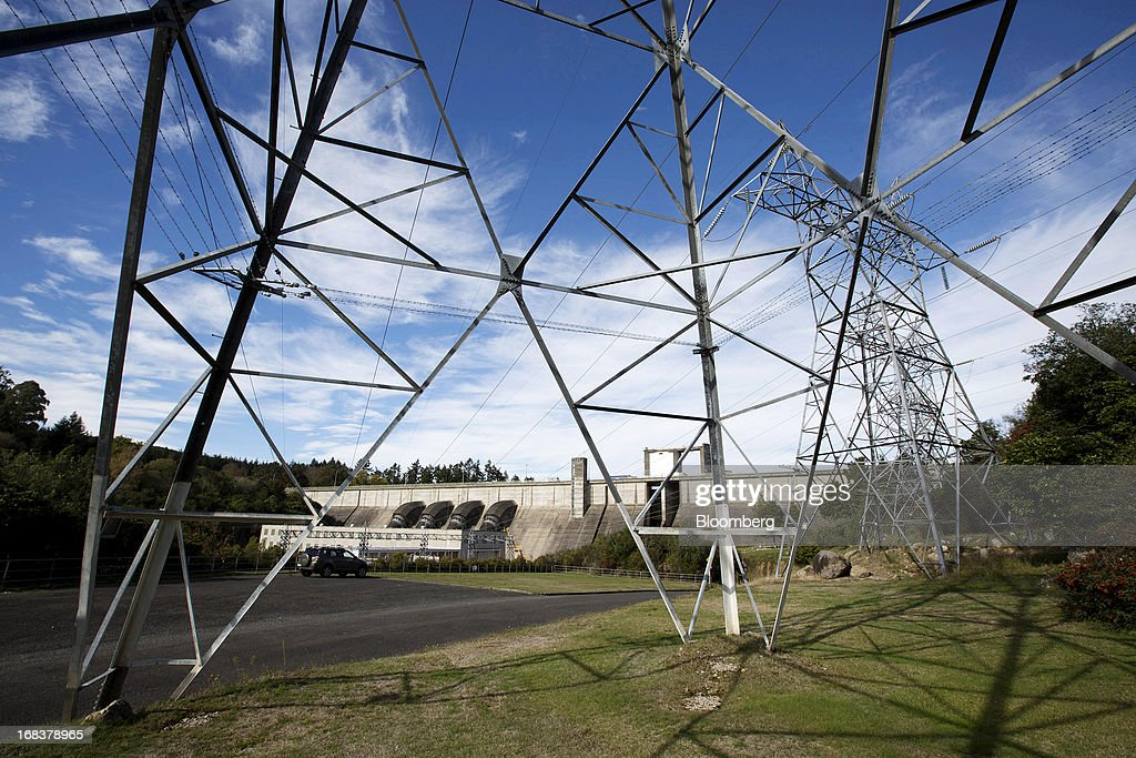 Transmission towers stand near the Whakamaru hydroelectric power station, operated by Mighty River Power Ltd., in Whakamaru, New Zealand, on Wednesday, May 8, 2013. New Zealand raised NZ$1.7 billion ($1.4 billion) from the sale of Mighty River shares as the nation's biggest initial public offering closed at a price at the lower end of the indicative range. Photographer: Brendon O'Hagan/Bloomberg via Getty Images